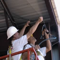 Instlling bird netting on or under canopies and structures takes team work and the right tools