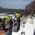 Installing shock track to all of the edges of the parapets walls using safety equipment and tie-offs.